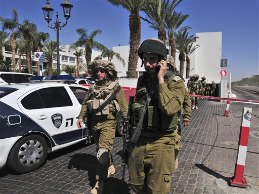Israeli soldiers secure the area near the site of a shooting incident at a hotel in the Red Sea resort town of Eilat, Israel on Friday.