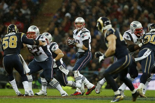 New England Patriots quarterback Tom Brady looks across the field during the second half of an NFL football game against the St. Louis Rams at Wembley Stadium, in London, Sunday, Oct. 28, 2012. (AP Photo/Matt Dunham)