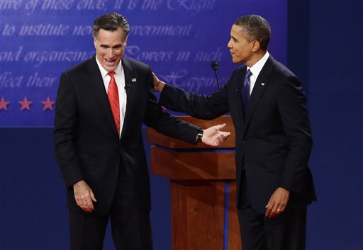 President Barack Obama and former Massachusetts Gov. Mitt Romney talk at the end of the first presidential debate in Denver on Wednesday.