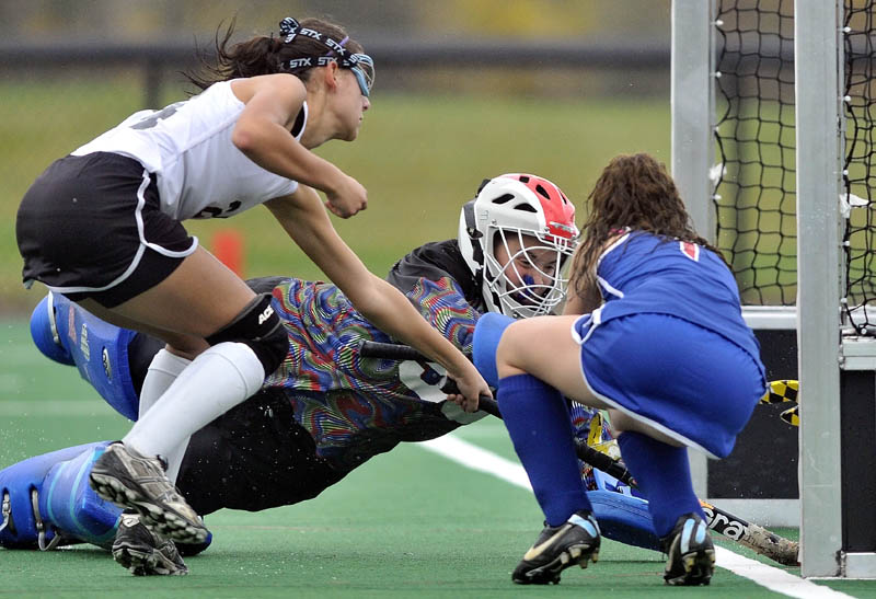 SCORE THE GOAL: Skowhegan's Rylie Blanchet, left, scores a goal on Mt. Ararat goalie Taylor Pare, center, while Paige Perry, right, tries to defend during the Indians 11-0 win in the Eastern A regional semifinals Saturday at Colby College in Waterville.