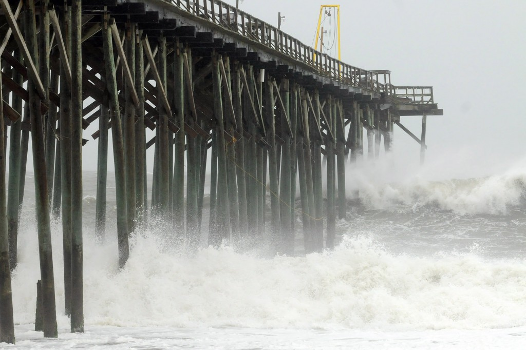 Waves pound Carolina Beach pier in Carolina Beach, N.C., Saturday, as Hurricane Sandy churns in the Atlantic Ocean. Hurricane Sandy, upgraded again Saturday just hours after forecasters said it had weakened to a tropical storm, was barreling north from the Caribbean and was expected to make landfall early Tuesday near the Delaware coast, then hit two winter weather systems as it moves inland, creating a hybrid monster storm.