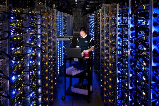An undated photo provided by Google shows a Google technician working on some of the computers in the Dalles, Ore., data center.