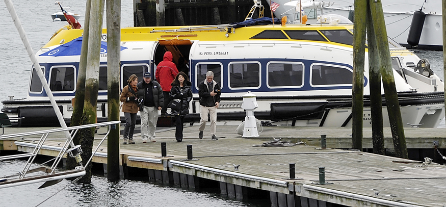 Condominium owners of The World disembark from a tender that carries owners to port from the moored ship just off Rockland Breakwater Lighthouse. They plan a couple of days in Rockland, then Portland and then off to Bermuda, according to a couple of owners who asked not to be identified for personal reasons.