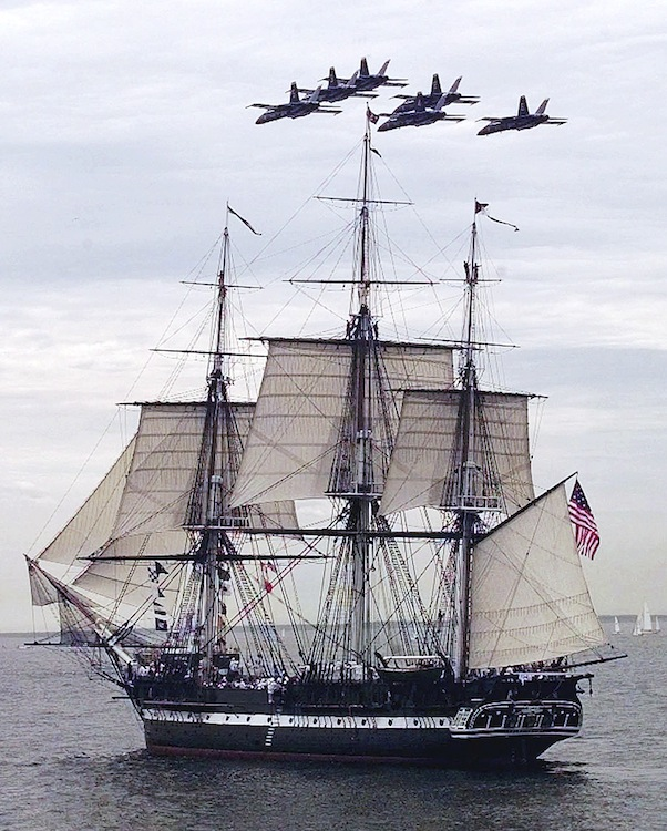 In this July 21, 1997, photo, the Blue Angels fly in formation over the USS Constitution as she free sails off the coast of Marblehead, Mass.