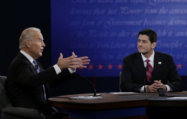 Republican vice presidential nominee Rep. Paul Ryan, of Wisconsin, right, listens as Vice President Joe Biden speaks during the vice presidential debate at Centre College, Thursday, Oct. 11, 2012, in Danville, Ky. (AP Photo/Eric Gay)