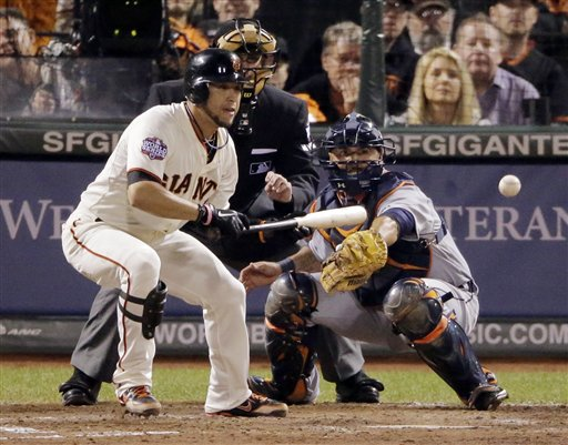 San Francisco Giants' Gregor Blanco bunts to load the bases during the seventh inning of Game 2 of baseball's World Series against the Detroit Tigers, Thursday, Oct. 25, 2012, in San Francisco. (AP Photo/Charlie Riedel) MLB