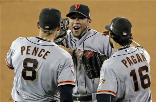 San Francisco Giants' Hunter Pence (8), Gregor Blanco and Angel Pagan (16) celebrate after San Francisco Giants beat Detroit Tigers 2-0 in Game 3 of baseball's World Series Saturday, Oct. 27, 2012, in Detroit. (AP Photo/Charlie Riedel) MLB