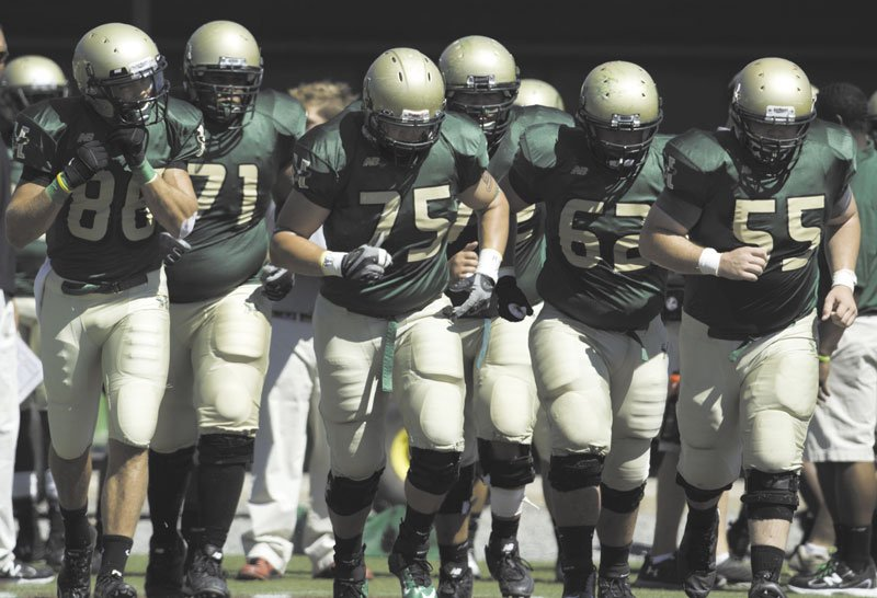 LEADING THE WAY: Messalonskee High School graduate Cody Ziegenfus (75) is one of two returning players on the offensive line at Husson University. Ziegenfus, a junior tackle, has taken on a leadership role this season because of the team's lack of upperclassmen.