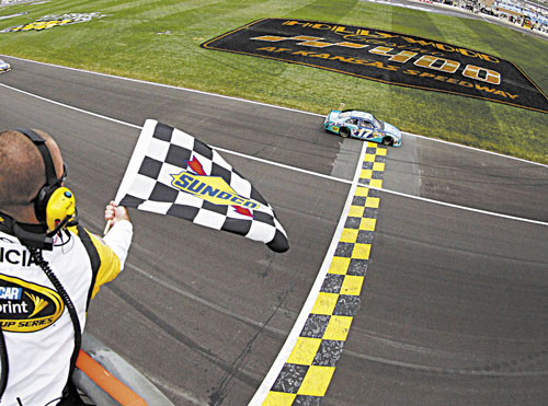 FIRST TO FINISH: Matt Kenseth (17) takes the checkered flag to win the NASCAR Sprint Cup Series race Sunday at Kansas Speedway in Kansas City, Kan.