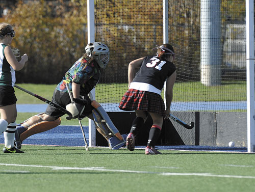 IT'S GOOD: Lisbon High School's Arianna Kahler (31) follows her shot as Winthrop goalie Alyssa Arsenault tries to make the stop in the first half of the Class C state championship game Saturday in Orono.