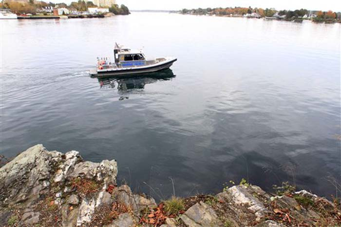 The New Hampshire Marine Patrol continued to search the Piscataqua River near a cliff on Pierce Island for the body Elizabeth