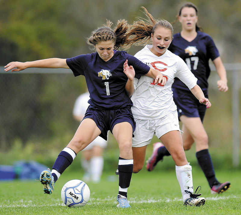 Foot race: Mount Blue High School's Eryn Doiron (1) attempts to drive the ball away from Cony High School's Olivia Deeves as Mt. Blue's Miranda Nicely (17) closes in during a soccer game Tuesday in Augusta.