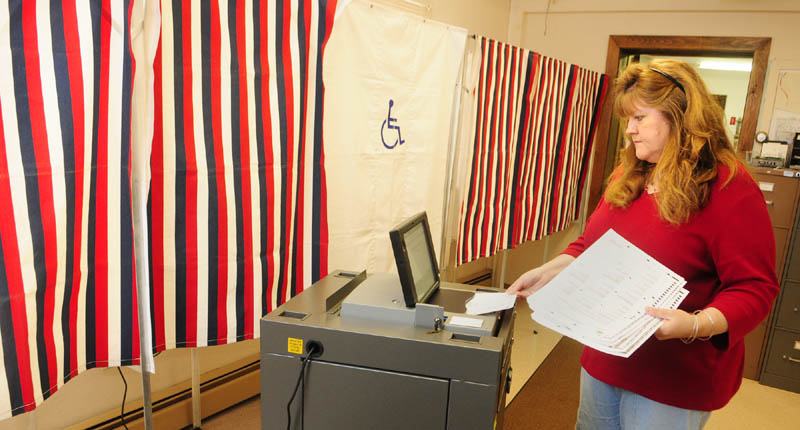 Town Clerk Lisa Gilliam runs a test on Chelsea's new IntElect DS200 electronic ballot-counting machine on Friday afternoon.