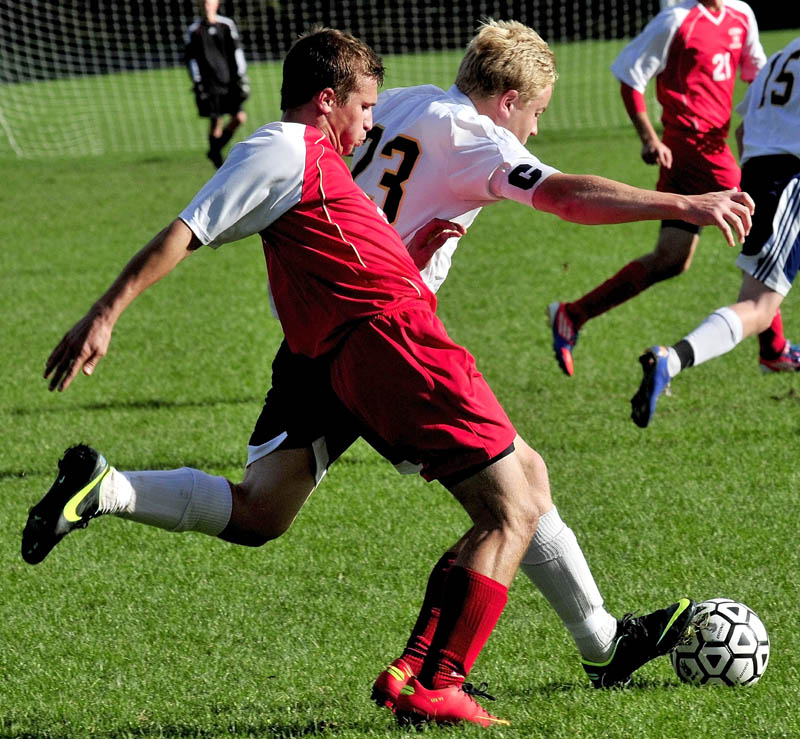 IT'S MINE: Cony's Chris Paradis, left, and Mt. Blue's Jamie Schanck battle for possession of the ball Monday in Farmington.