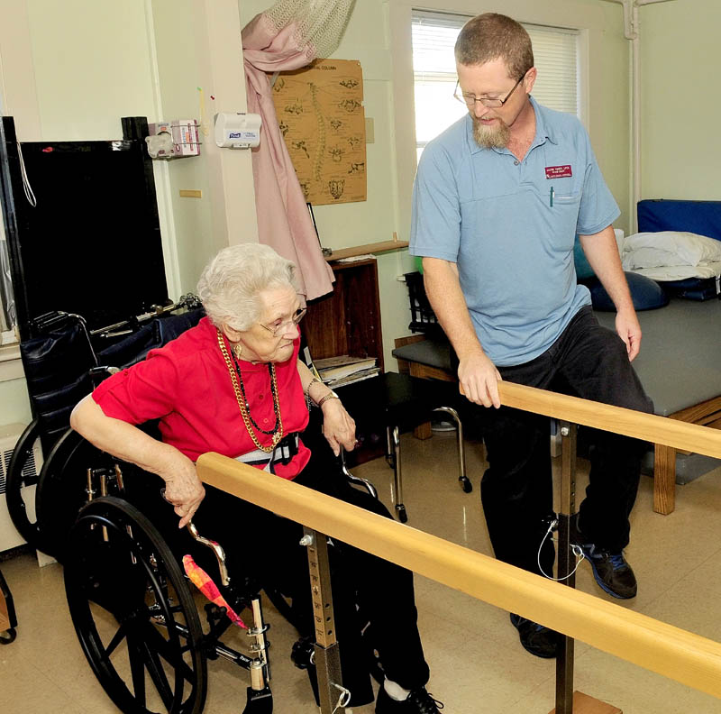 Physical therapist assistant Jason Toner works with a client at the Sanfield Rehabilitation Living Center in Hartland. Toner has received two awards for his work.