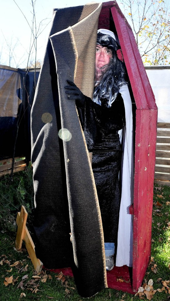 WELCOME: Dressed as a vampire, Shannon Dunton opens her coffin in the cemetery section of the