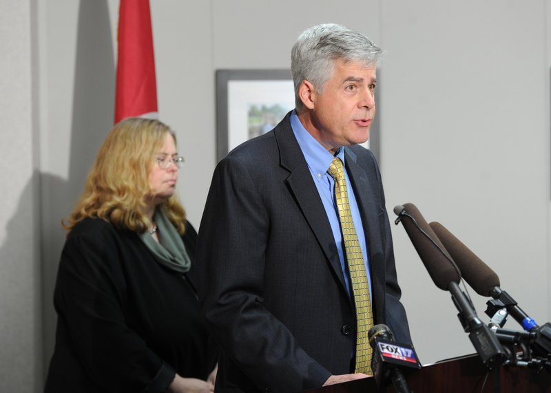 Dr. David Reagan, the Tennessee Department of Health chief medical officer, right, tells the media Wednesday about the outbreak of fungal meningitis infections.