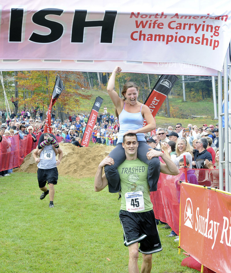 Michael and Jessica Keefe of Effingham, N.H., celebrate their finish.