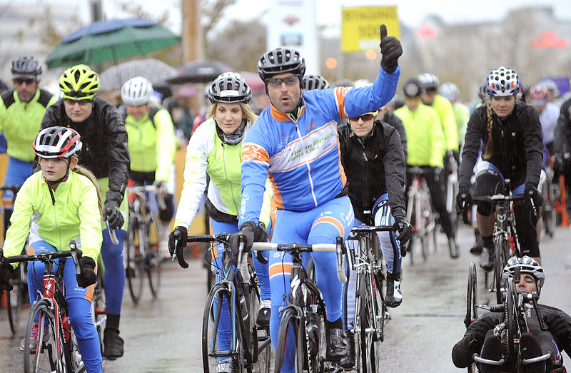 Actor Patrick Dempsey leads the group of riders at the fourth annual Dempsey Challenge in Lewiston on Sunday. The event raised more than $1 million for the first time.