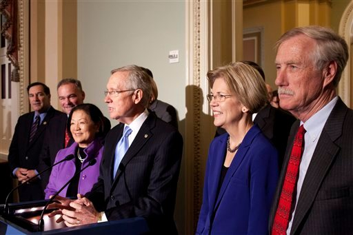 Senate Majority Leader Harry Reid of Nev., center. accompanied by incoming Senate Democrats, speaks during a news conference on Capitol Hill in Washington, Wednesday, Nov. 14, 2012. From left are, Sen.-elect Joe Donnelly, D-Ind., Sen.-elect Tim Kaine, D- Va., Sen.-elect, current Rep. Mazie Hirono, D-Hawaii, Reid, Sen.-elect Elizabeth Warren, D-Mass.,and Sen. -elect Angus King, I-Maine, who will caucus with the Democrats. (AP Photo/Harry Hamburg)