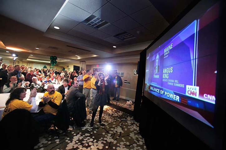 Angus King supporters cheer in Freeport on Tuesday night upon seeing CNN call Angus King the winner of the U.S. Senate race in Maine.