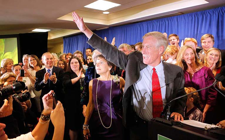 Angus King waves to supporters as he takes the stage in Freeport on Tuesday night after being declared the winner for the race for the U.S. Senate seat being vacated by Sen. Olympia Snowe.