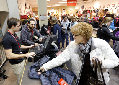 Joanne Weston of Dixfield purchases a jacket Friday at North Face in Freeport. Many of the Freeport stores opened at midnight on Friday with sales that brought a steady flow of customers.