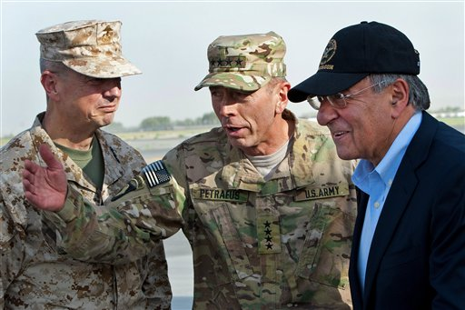 In this July 9, 2011 file photo, USMC Gen. John Allen, left, and Army Gen. David Petraeus, top U.S. commander in Afghanistan and incoming CIA Director, greet former CIA Director and new U.S. Defense Secretary Leon Panetta, right, as he lands in Kabul, Afghanistan, Saturday, July 9, 2011. (AP Photo/Paul J. Richards, Pool)