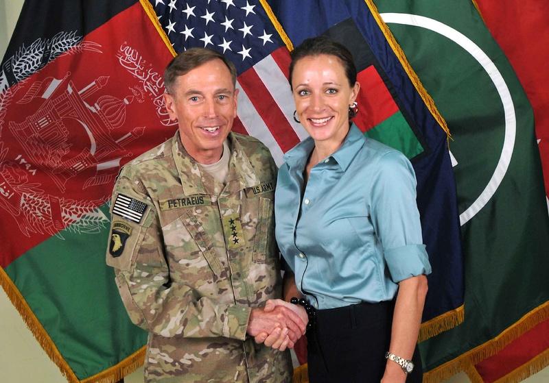 Davis Petraeus shakes hands with his biographer Paula Broadwell on July 13, 2011.