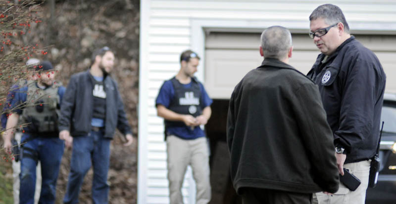 U.S. Marshal Service investigators search the residence of Barbara Cameron, the ex-wife of fugitive James Cameron, in Hallowell on Nov. 20. Authorities continue to hunt for Cameron, Maine's former top drug prosecutor, who cut off his electronic monitoring bracelet and fled after learning his appeal of child pornography convictions had failed earlier this month.
