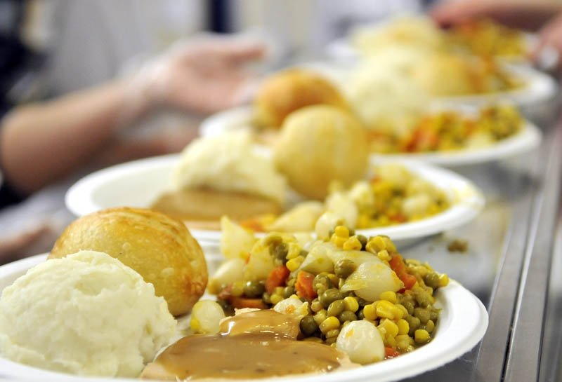 Plates of turkey, mixed vegetables, mashed potatoes and gravy wait to be served at the 23rd annual community Thanksgiving Day dinner at Messalonskee High School in Oakland, on Thursday. Over 900 people were served at the school's cafeteria and via delivered meals.