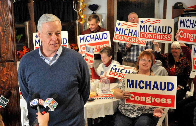 Staff photo by Michael G. Seamans Mike Michaud speaks to supporters after winning another term as the representative from the 2nd Congressional District during a campaign party at Grass Roots Cafe and Catering on Main Street in East Millinocket on Tuesday.