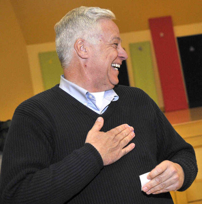 Staff photo by Michael G. Seamans Mike Michaud smiles after voting at the East Millinocket Town Hall on Tuesday.