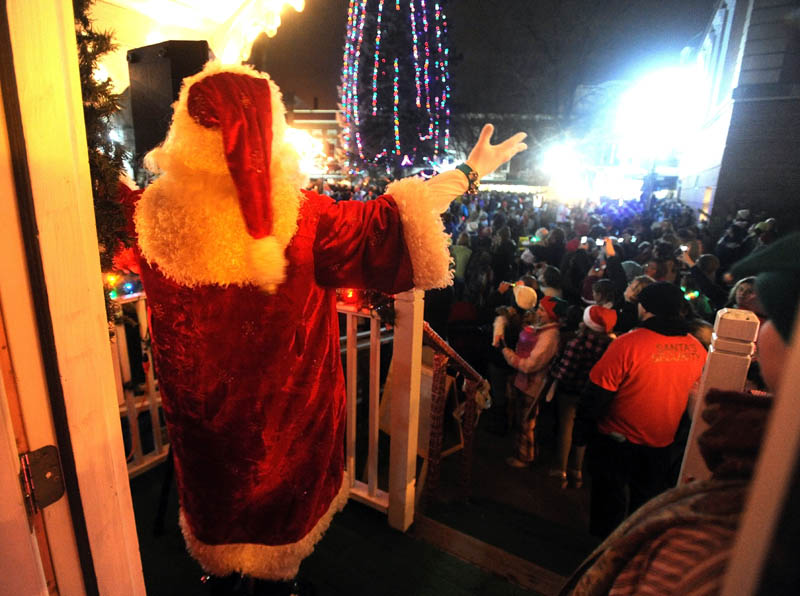 Santa Claus counts down for the annual tree lighting at Kringleville, in Castonguay Square in downtown Waterville, on Friday, after the annual Parade of Lights.