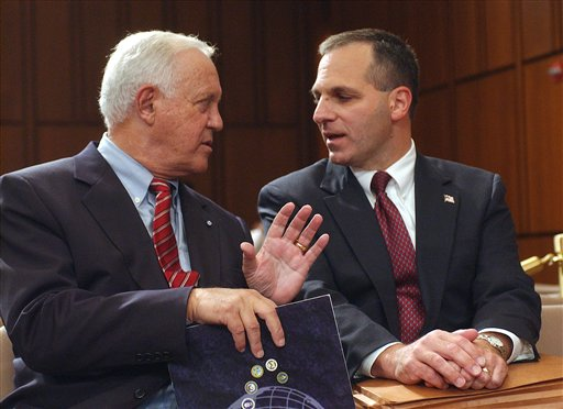 This Oct. 8, 2002, photo shows former New Hampshire Sen. Warren Rudman, left, talking with former FBI Director Louis Freeh on Capitol Hill in Washington.