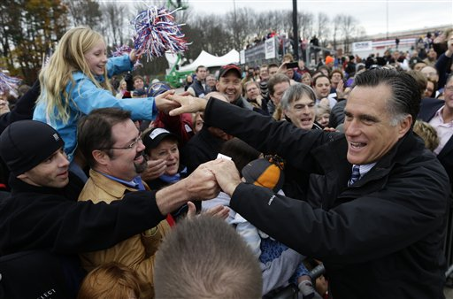 Republican presidential candidate Mitt Romney greets supporters as he campaigns at Portsmouth International Airport, in Newington, N.H., on Saturday.
