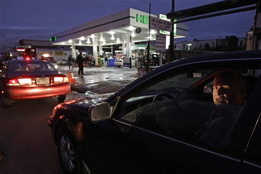 David Kahana, who said he had been sitting in line for an hour and 40 minutes, waits to purchase gasoline in Brooklyn on Thursday.