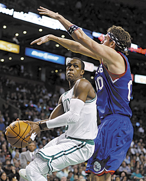 STEP BACK: Boston's Rajon Rondo, left, makes a move against Philadelphia's Spencer Hawes during the second quarter of the Celtics 106-100 loss Friday in Boston.