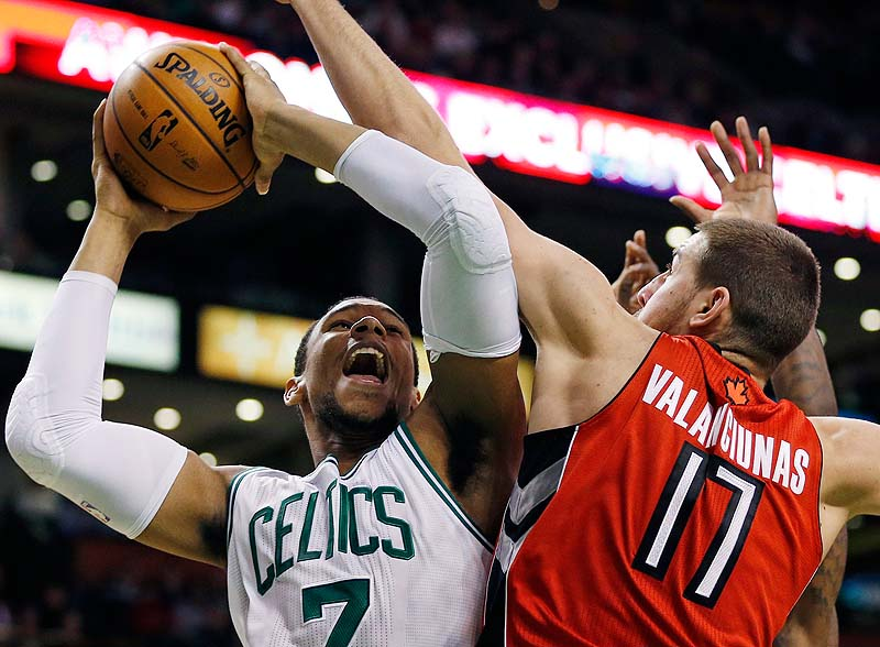 Toronto Raptors' Jonas Valanciunas, 17, blocks a shot by Boston's Jared Sullinger in Saturday's game at Boston. The Celtics won, 107-89.