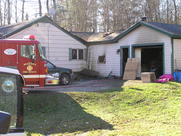 The scene of a Saturday morning fire that damaged a home at 816 Civic Center Drive in Augusta. Two people were injured and a dog was killed in the blaze, according to Augusta Fire Department Battalion Chief Dave Groder.