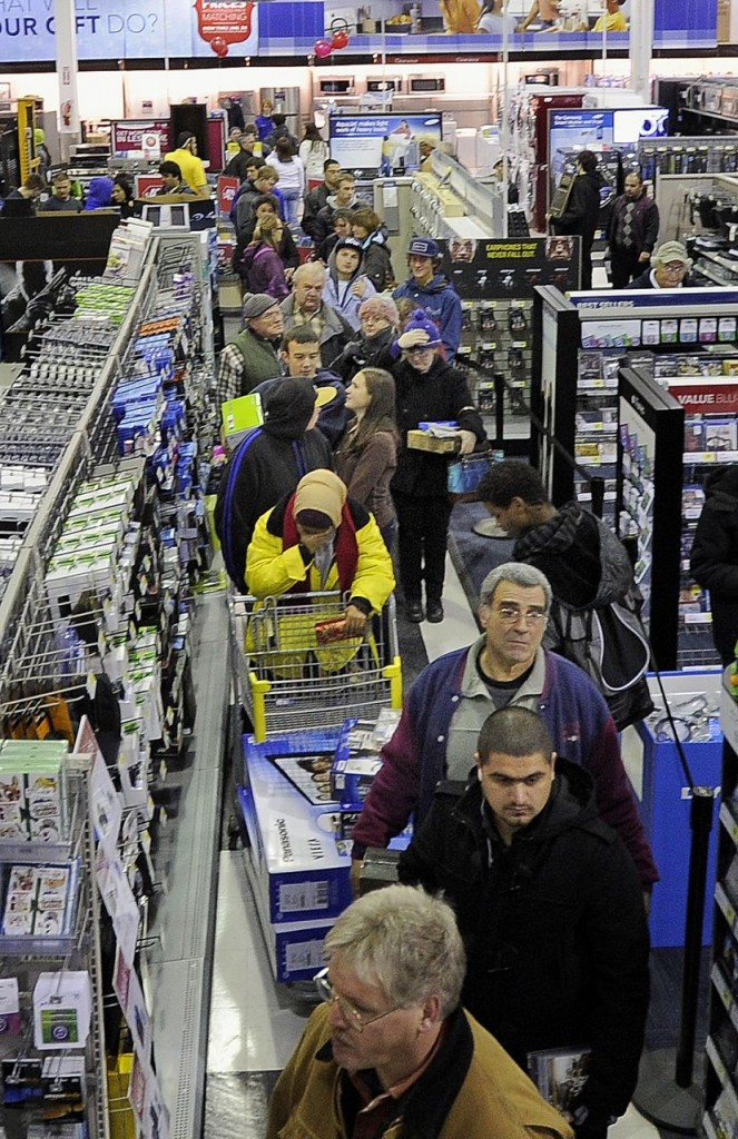 Black Friday shoppers wait in the checkout line just after midnight at the Best Buy in the Maine Mall in South Portland on Friday.