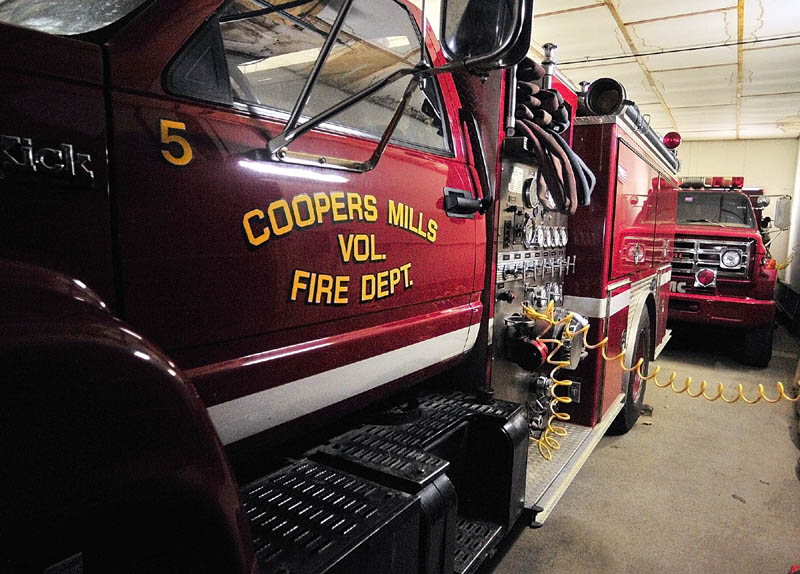 Engine 5 and Tank 1 share a bay door at the Coopers Mills fire station in Whitefield. Coopers Mills Volunteer Fire Department Association Chief Tim Yorks said that sometimes they have to shuffle trucks if there is a mutual aid request for a tank truck from another town.