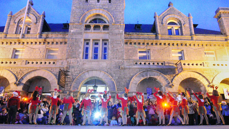 Dancers perform on Water Street, in front of the Olde Federal Building, before the annual tree lighting on Saturday in downtown Augusta.