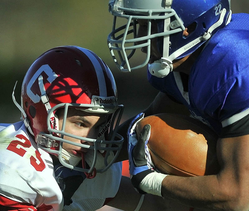 Staff photo by Jim Evans Cony High School's Tayler Carrier, left, gets an eyeful from Lawrence High School's Xavier Lewis Saturday.