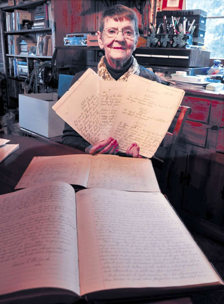 Maxine Russakoff holds some documents, including the 1882 constitution of the Skowhegan Women's Club. The organization is celebrating its 130th anniversary.