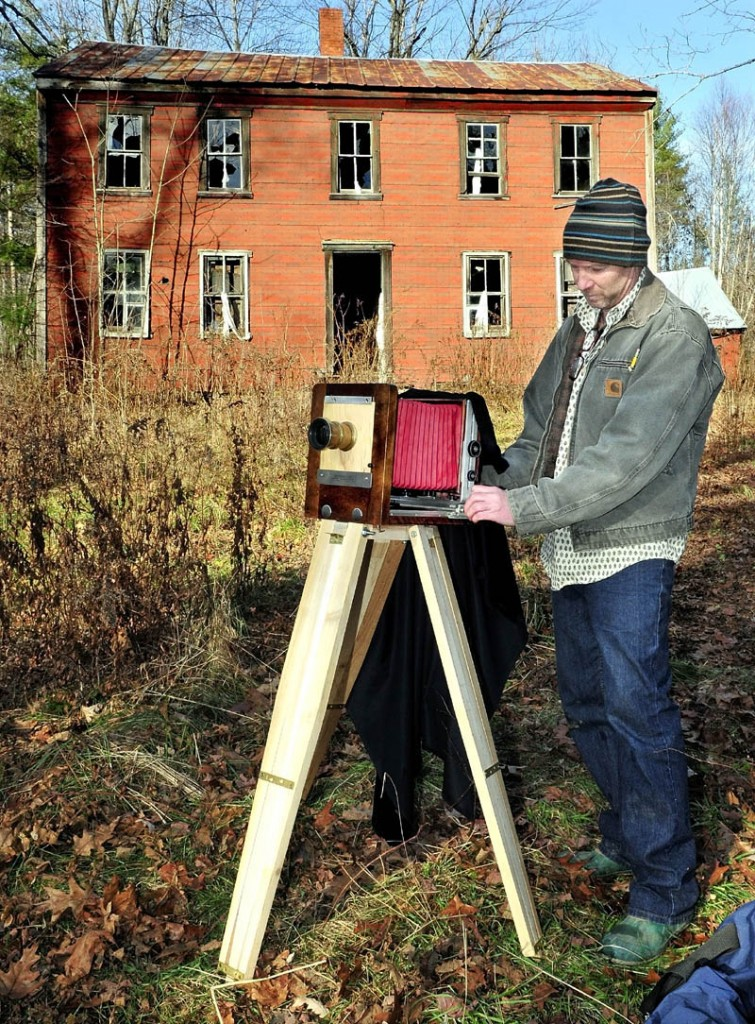 Scott Anton prepares his view camera, which uses glass-plate negatives, to photograph the John Wentworth home in Athens, which was built in 1800. Anton is documenting the old home, as it may be torn down next year.