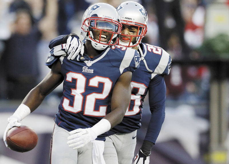 IT'S OVER: New England Patriots cornerback Devin McCourty, left, celebrates with safety Steve Gregory after McCourty intercepted a pass in the end zone against the Buffalo Bills in the last minutes of the Patriots' 37-31 win Sunday at Gillette Stadium in Foxborough, Mass. NFLACTION12; Gillette Stadium