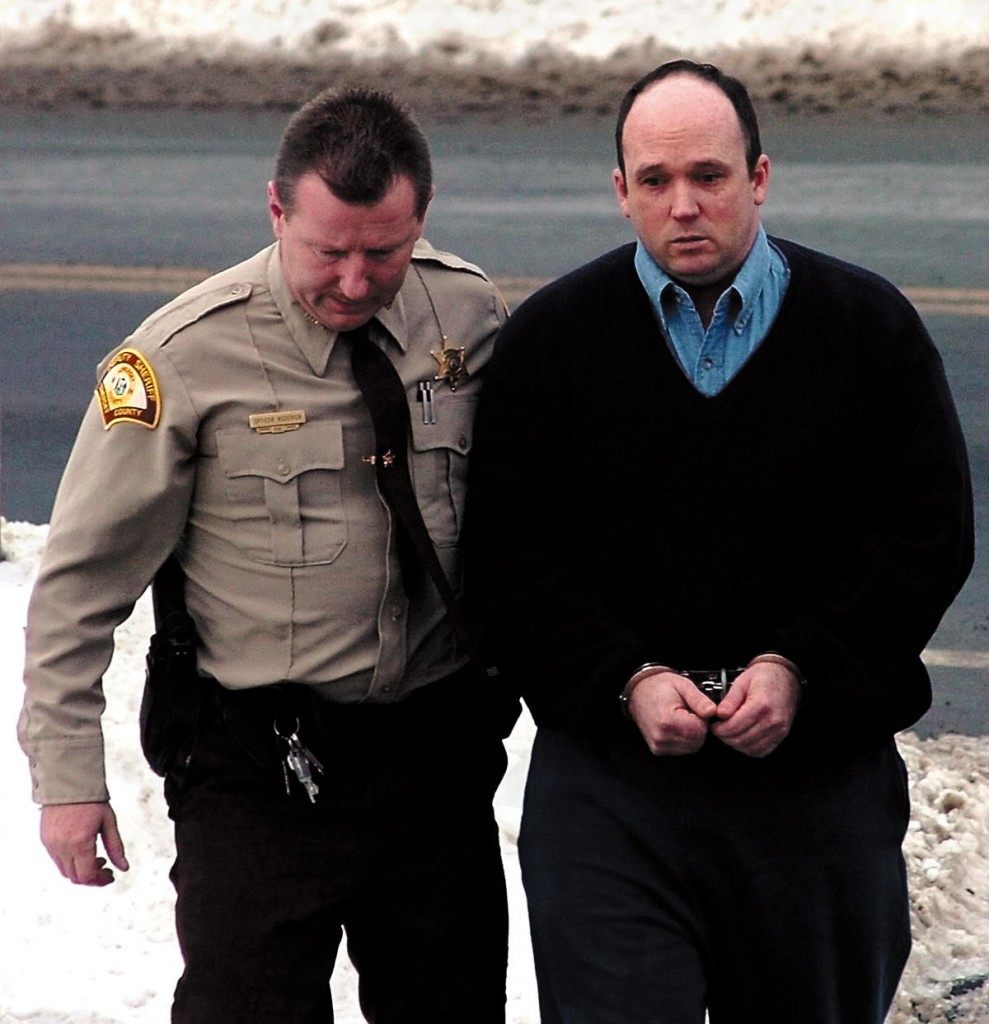 Todd Curry is led into Somerset Superior Court in Skowhegan on March 18, 2010.