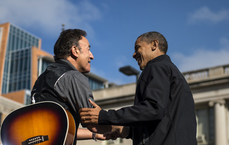 Bruce Springsteen shares a moment with President Barack Obama in Madison, Wis., on Monday. The president urged a crowd of 18,000 supporters to help keep him in the White House.
