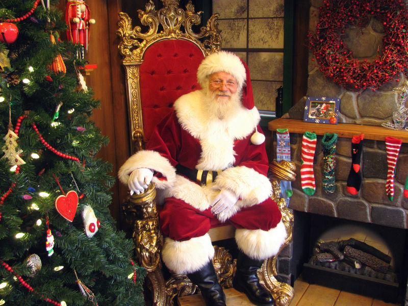 Santa Claus, a.k.a. Rob Hoffman, of Rangeley, gets ready to greet hundreds of children expected to visit Santa's Workshop on Friday, at President's park in Washington, D.C. Hoffman, a retired airline pilot who has moonlighted as Santa for eight years, landed the gig to sit in for Santa for most of December at the holiday display on The Ellipse, near the National Christmas Tree.